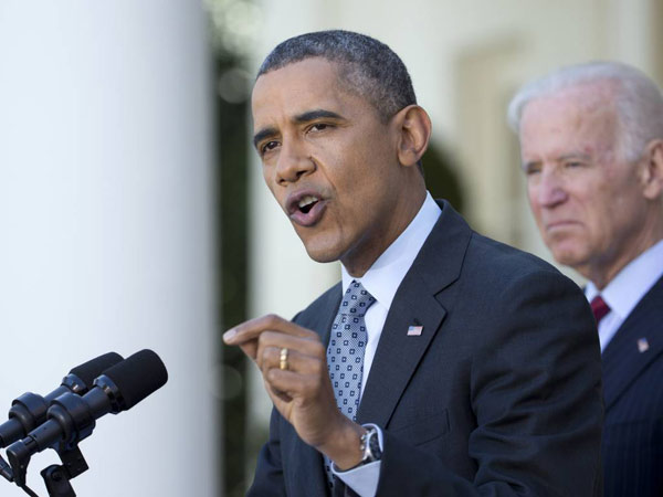 President Barack Obama , accompanied by Vice President Joe Biden speaks about the Affordable Care Act, Tuesday, April 1, 2014, in the Rose Garden of the White House in Washington.  (AP Photo/Manuel Balce Ceneta)