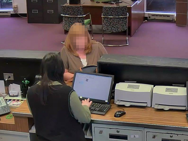 Police initially believed this surveillance photo showed a fraud suspect but later realized a bank mix-up caused confusion.