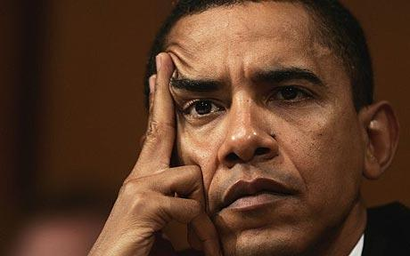 President Obama in a pensive moment. (Associated Press)