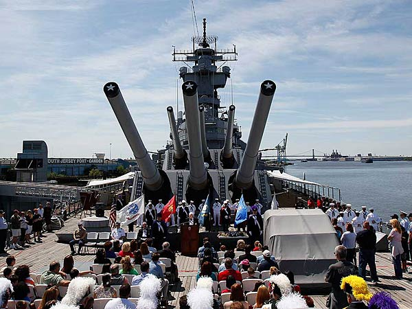 A crowd gathers on the deck of the Battleship New Jersey to watch a Memorial Day ceremony in Camden, NJ on May 27, 2013.  ( DAVID MAIALETTI / Staff Photographer )