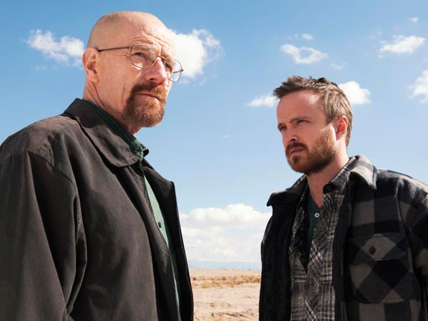 "This image released by AMC shows Bryan Cranston, left, and Aaron Paul in a scene from ""Breaking Bad.""  Paul is nominated for best supporting actor in a drama series for his role as Jesse Pinkman. The Academy of Television Arts & Sciences´ Emmy ceremony will be hosted by Neil Patrick Harris. It will air Sept. 22 on CBS.  (AP Photo/AMC, Frank Ockenfels )"