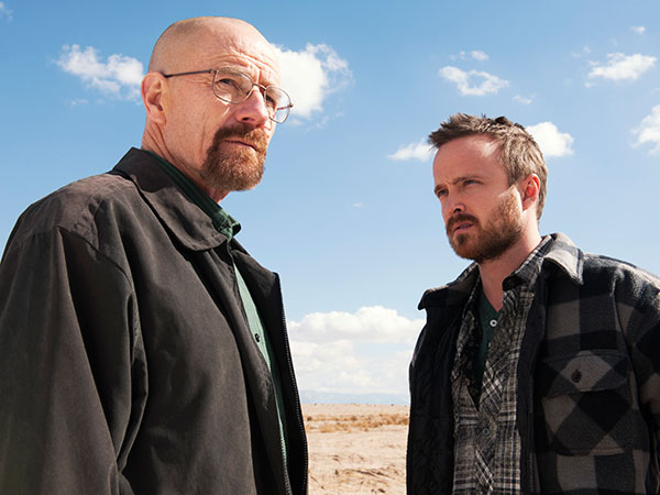 "This image released by AMC shows Bryan Cranston as Walter White, left, and Aaron Paul as Jesse Pinkman in a scene from ""Breaking Bad.""  (AP Photo/AMC, Frank Ockenfels )"