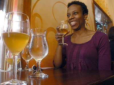 No raised pinky required: Monica Ferguson enjoys the Ladies Beer Tea at the Belgian Cafe. (April Saul / Staff Photographer)