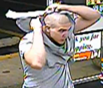After smashing front door glass, this man is seen on camera at 7-Eleven in Bensalem on Aug. 23, 2012.