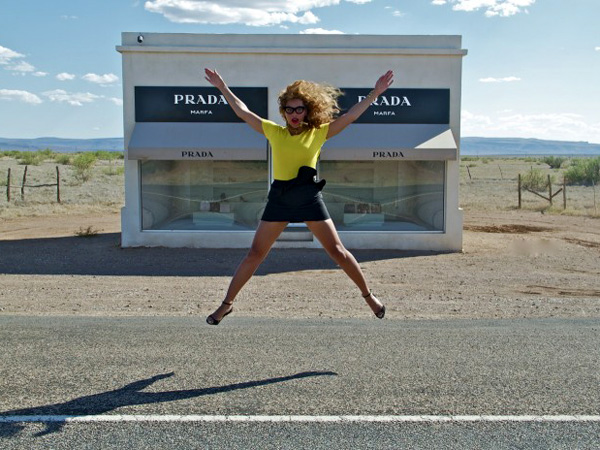 Beyonce jumps for joy in front of the Prada Marfa sign. (Photo / Beyonce)
