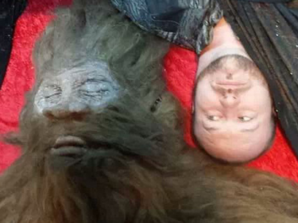 Bigfoot hunter Rick Dyer with creature he says he shot in San Antonio in Sept. 2012. This was taken after it was scientifically studied and taxonomied.