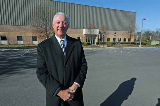 Bill Thomas, head of Compassionate Care Foundation, Inc., stands in front of a former factory in Westampton factory where he would like to open a pot farm.  (By April Saul/Staff Photographer)