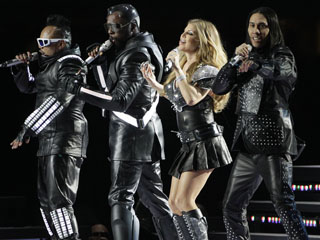 The Black Eyed Peas featuring Fergie, will.i.am, Taboo and apl.de.ap perform during halftime of the NFL Super Bowl XLV football game Sunday, Feb. 6, 2011, in Arlington, Texas. (AP Photo/Patrick Semansky)