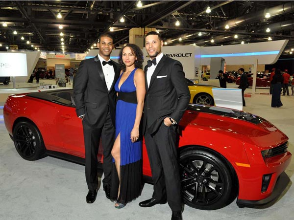 Dean Haller, Lana Grigoriev (Mount Royal, NJ) with William E. Brown III (Duke Barber Co., Master Barber) at the Black Tie Tailgate of the Philadelphia Auto Show at the Pennsylvania Convention Center on Jan. 18, 2013. ( Al B. For / Philly.com )