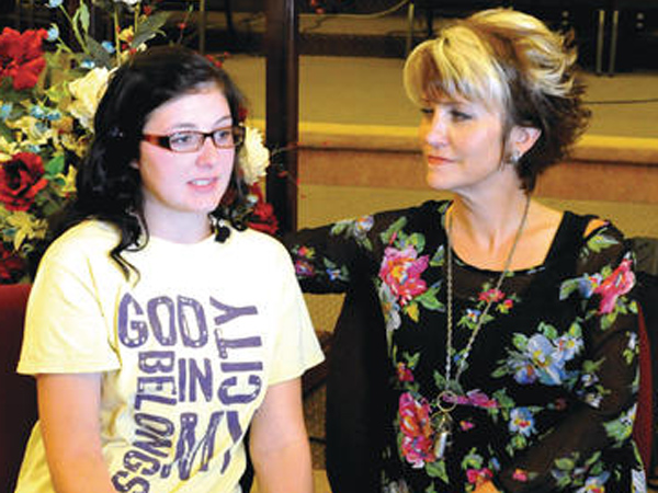 "Dyer County High School senior Kendra Turner with, Becky Winegardner, a youth pastor at Dyersburg First Assembly of God during a news conference about Turner´s in-school suspension over saying, ""Bless you."" (Photo by Dyersburg State Gazette)"