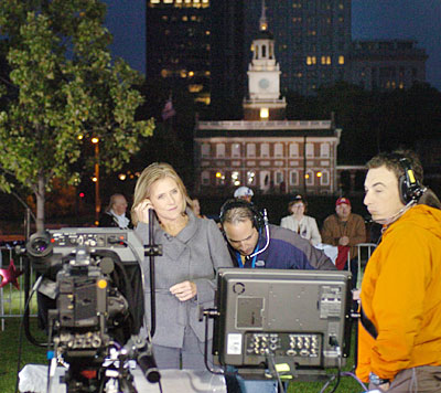 It´s only 6:28 a.m. but Today Show co-host Meredith Vieira is already on the set in Philadelphia Independence Mall (that´s The Hall in the background) as she gets wired up before the show.  (Photo by Clem Murray / Inquirer)
