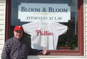 Phillies fan Lawrence Bloom, a Delaware County native, gives a thumbs-up sign outside his law office in Skowhegan, Maine.