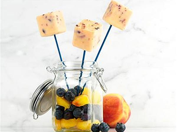 Peaches and blueberry cream popsicle bites. (Photo via Parade)