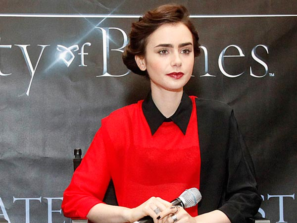 Lily Collins throws Ta...