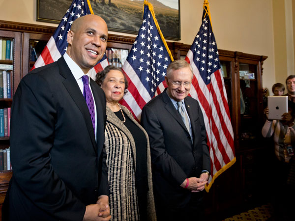 Newly-elected Democratic senator from New Jersey, former Newark Mayor Cory Booker, left, and his mother, Carolyn Booker, meet with Senate Majority Leader Harry Reid of Nev., before being officially sworn in on the floor of the Senate, Thursday, Oct. 31, 2013, on Capitol Hill in Washington.  (AP Photo/J. Scott Applewhite)