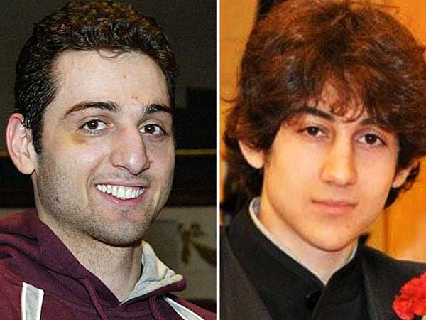 The FBI says the two brothers and suspects in the Boston Marathon bombing killed an MIT police officer, injured a transit officer in a firefight and threw explosive devices at police during a getaway attempt in a long night of violence. (AP Photo/The Lowell Sun & Robin Young)