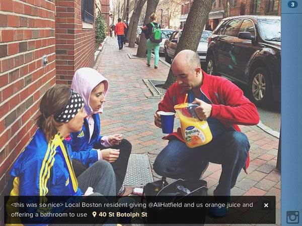A Boston resident offers runners orange juice. (Instagram photo)