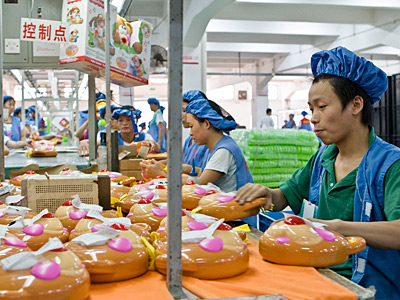 Workers assemble plastic toys at a production line in a factory in Dongguan, China, September 20, 2007. A new study of Chinese factory workers found a link between bisphenol a and male sexual dysfunction. (Michael Lassman /Chicago Tribune /MCT/ file)