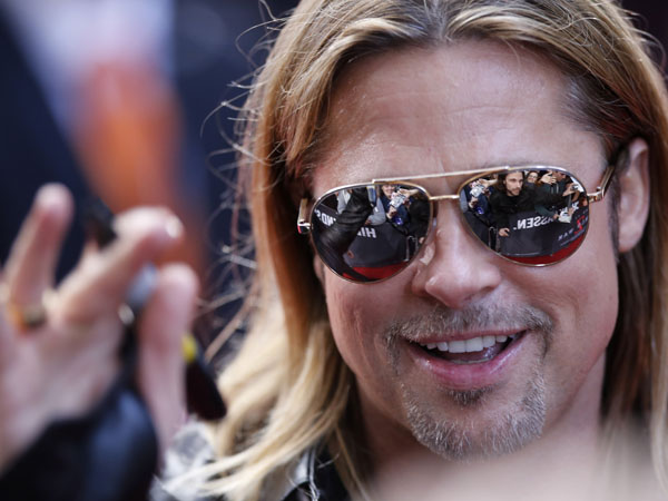 US actor Brad Pitt waves to fans prior to the German premiere of World War Z in Berlin, Germany, Tuesday, June 4, 2013. (AP Photo/Ferdinand Ostrop)