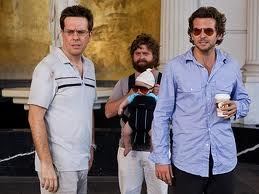 "Three men and a baby, also known as ""The Hangover."""