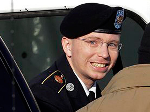 File photo: Army Pfc. Bradley Manning, center, steps out of a security vehicle as he is escorted into a courthouse in Fort Meade, Md., for a pretrial hearing in Nov. 2012. Manning is charged with aiding the enemy by causing hundreds of thousands of classified documents to be published on the secret-sharing website WikiLeaks. (AP/Patrick Semansky)