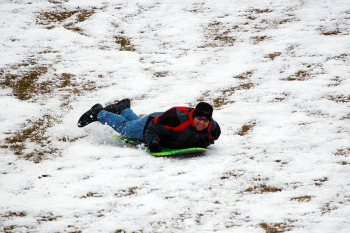 Cinnaminson Mayor Don Brauckmann tests out the new sledding hill (Photo submitted by Brauckmann)