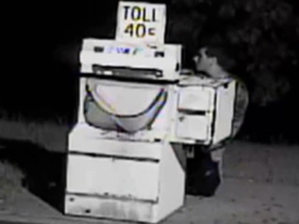 A man in his 20s seen breaking into a toll booth collection machine on the Atlantic City Expressway in Gloucester Township, June 18, 2013.