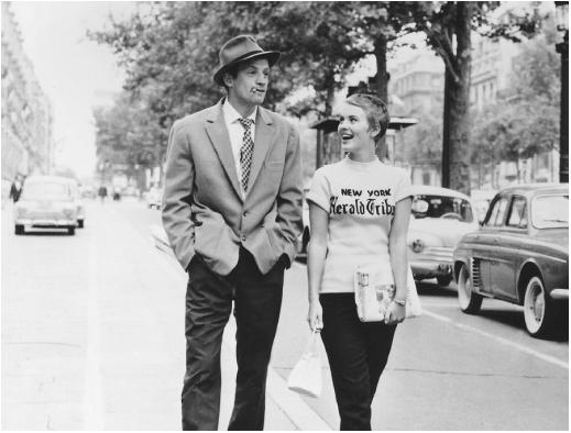 "Rakish Jean-Paul Belmondo strolls down the boulevard with brainy bombshell Jean Seberg in Godard´s ""Breathless"" (1960)."