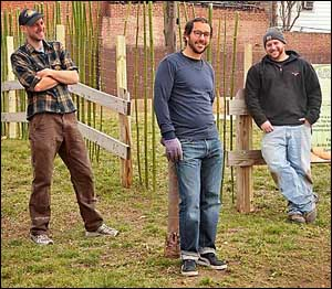 Urban-farm promoter (from left) Patrick Dunn with Marathon Restaurants CEO Cary Borish and farm director Adam Hill.