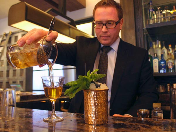 Brian Bevilacqua pours one at Bank & Bourbon at the Loews Philadelphia.