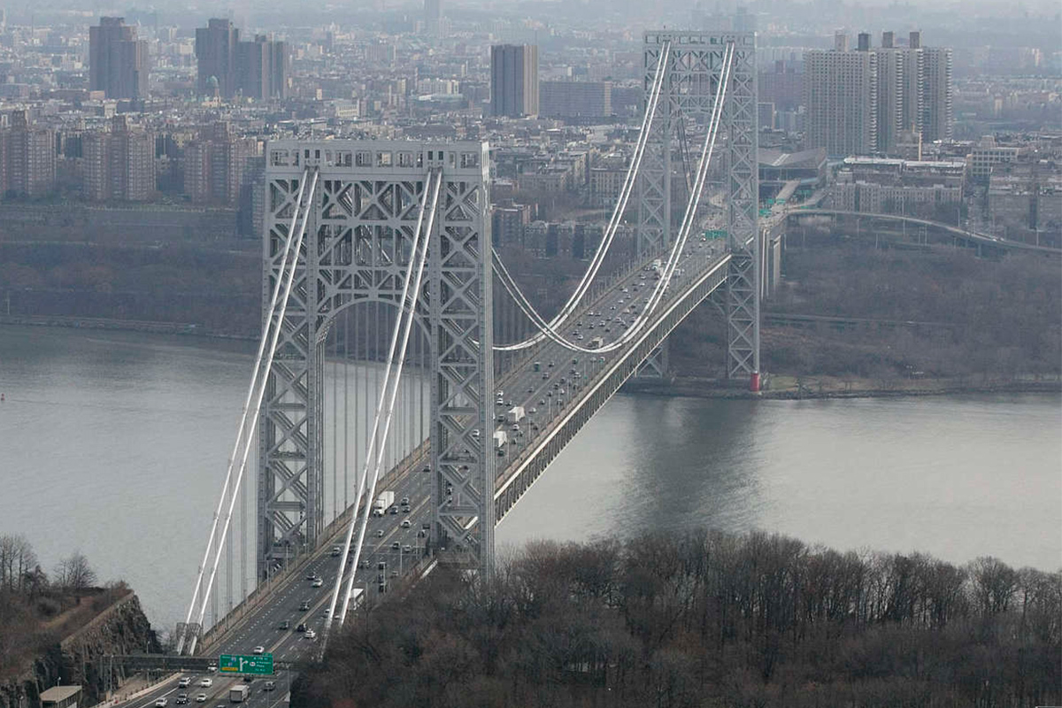 Tollbooth lanes (lower left) leading to the George Washington Bridge in Fort Lee, N.J. A New Jersey judge on Thursday ruled there was no probable cause that Gov. Christie violated state law in 2013 by allegedly refusing to order his aides to reopen lanes at the George Washington Bridge that had been closed in an act of political revenge.