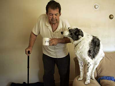 Richard Hershman, 62, of Northeast Philadelphia with his dog, Blue. He broke his arm in January; he couldn´t get surgery until March. (MICHAEL PEREZ / Staff Photographer)