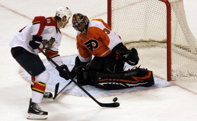 Flyers goalie Ilya Bryzgalov stops a shot on goal from<br />Florida Panthers&acute; Shawn Matthias in the first period  on Thursday night, March 8, 2012. <br />( LAURENCE KESTERSON / Staff Photographer )