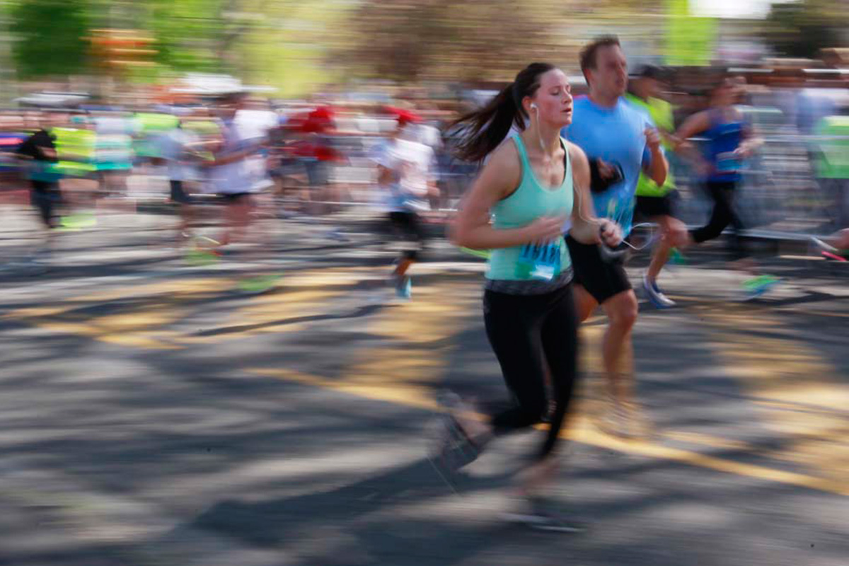 Eileen Quinn, of Philadelphia, center, runs toward the finish line in this blurred effect photograph, during the 2015 Broad Street Run.