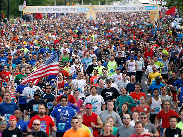 Thousands of runners take off from the starting line during the Broad Street Run on Sunday.