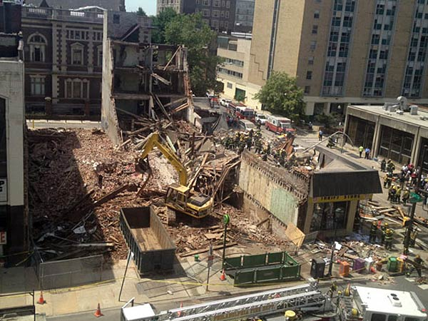 A view from across Market Street of the rubble of collapsed buildings on June 5, 2013. (AP Photo/Dino Hazell)