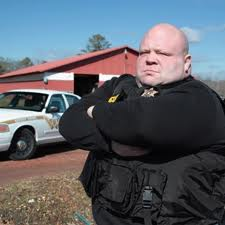 Butterbean Esch and the weighty arm of the law