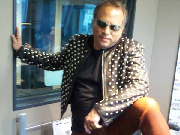 Buzz Bissinger wearing a studded leather jacket.