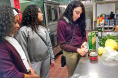 Camden Promise Charter School students Taniyah Waples, Paola Rodriguez, and Melany Morales improvised when the required salad dressing ingredients weren't available for their week 3 My Daughter's Kitc