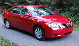 Maybe the 2009 Camry Hybrid Sedan is the way to go, as long as it´s red!