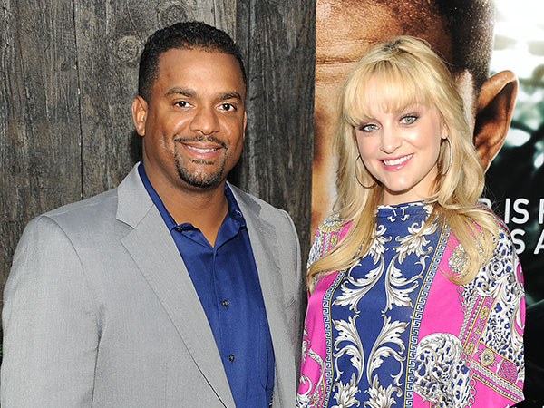 "Actor Alfonso Ribeiro and wife Angela attend the ""After Earth"" premiere at the Ziegfeld Theatre on Wednesday, May 29, 2013 in New York. (Photo by Evan Agostini/Invision/AP)"