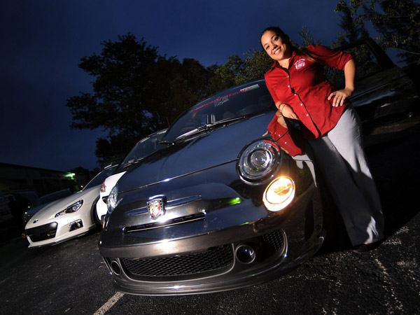 Stephanie Rivero shows off her customized Fiat 500 Abarth in Sunrise, Florida, on September 5, 2013. (Robert Duyos/Sun Sentinel/MCT)