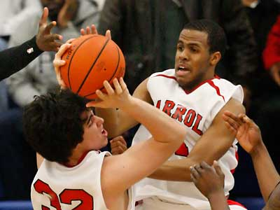 Archbishop Carroll´s Pat Finnegan (32) grabs a rebound in front of teammate DJ Irving in a game against Bartram on Saturday. ( Ron Cortes / Staff Photographer )