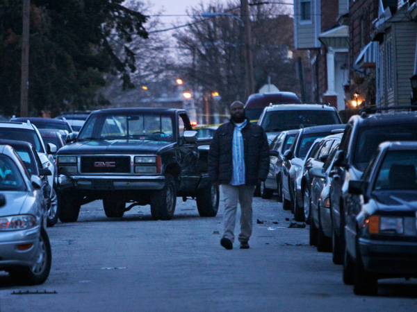 Shawn Grant of N. Allison St., Philadelphia, walks in the street to inspect his vehicle parked along the 1400 block.  There, police were called after a pickup truck apparently fleeing gunfire rammed several vehicles early March 27, 2013. (ALEJANDRO A. ALVAREZ / STAFF PHOTOGRAPHER )