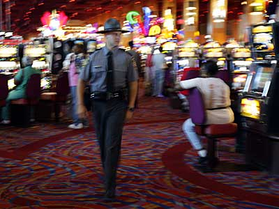 A state trooper patrols the gaming floor at Harrah´s in Chester. [File photo.]