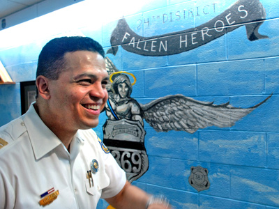 Indicted Inspector Daniel Castro was captain of the 24th District in June 2009 as he paused near a mural there honoring officers killed in the line of duty.