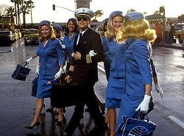 "Leonardo DiCaprio flanked by flight attendants in Spielberg´s ""Catch Me if You Can."""