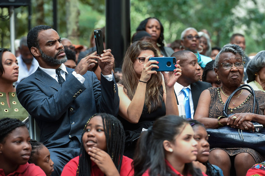 CAPTION CORRECTION  CORRECTS RELATIONSHIP  Jon Smith (left), the great-great-grand nephew of Octavius V. Catto takes photos during the dedication ceremony of the Octavius V. Catto Memorial on the southwest corner of City Hall September 26, 2017. The statue is the first of an African American hero on city property.  CLEM MURRAY / Staff Photographer