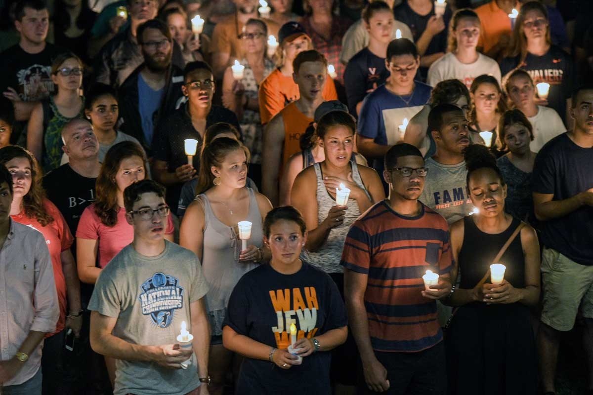 Hundreds of people march peacefully with lit candles across the University of Virginia campus in Charlottesville, Va., Wednesday. MUST CREDIT: Salwan Georges/The Washington Post.