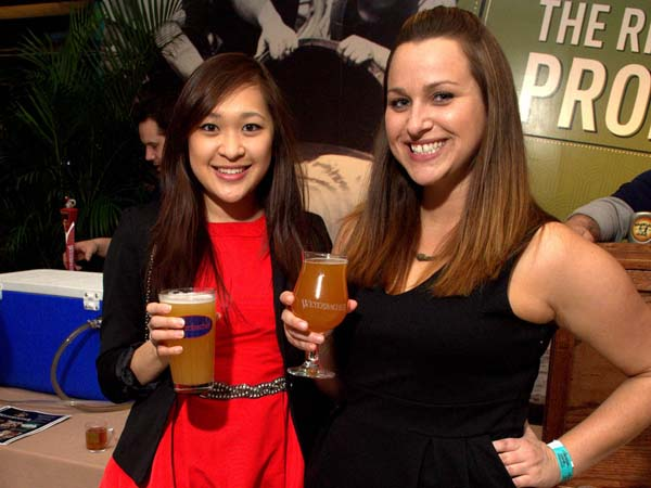 Victoria Lam and Kate Marlys (Philly PR Girl LLC) at the Cheers to Beer tasting event at the National Constitution Center on April 4, 2013. (Al B. For / Philly.com)